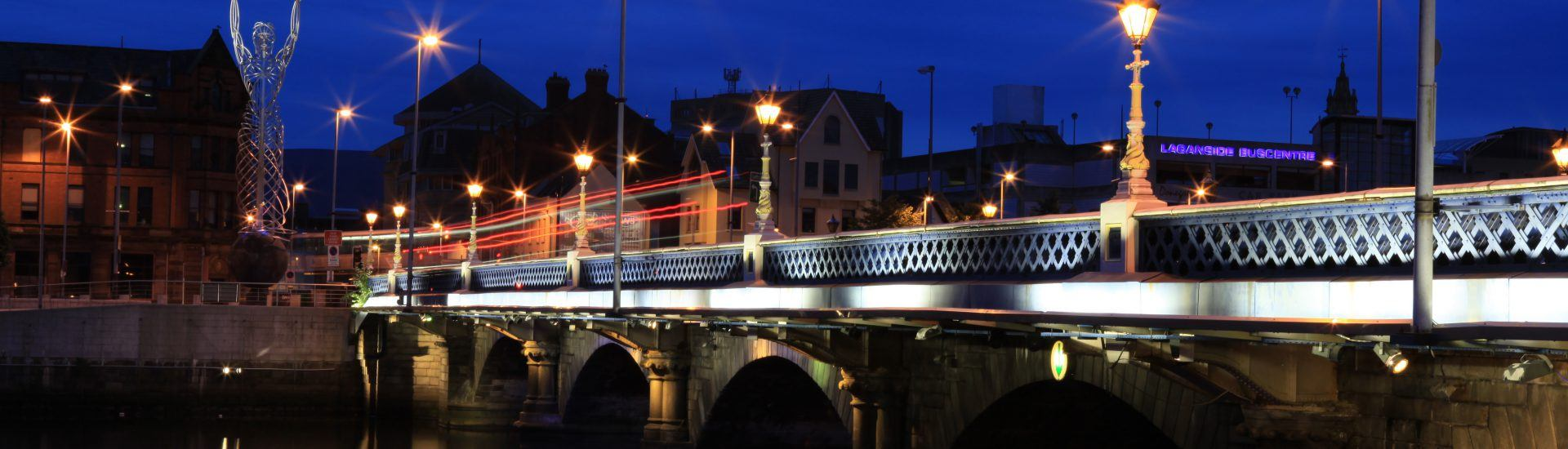 bridge and river at night in belfast